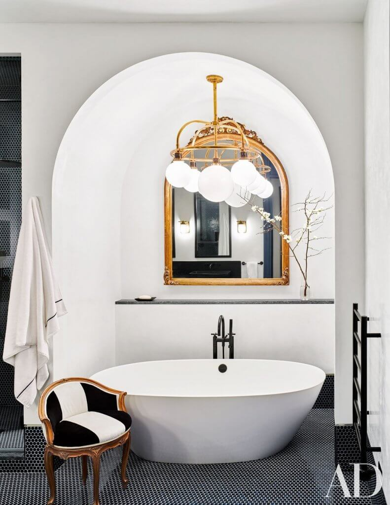 Decorating A Simple Vintage Mirror As A Highlight of Bathroom Wall