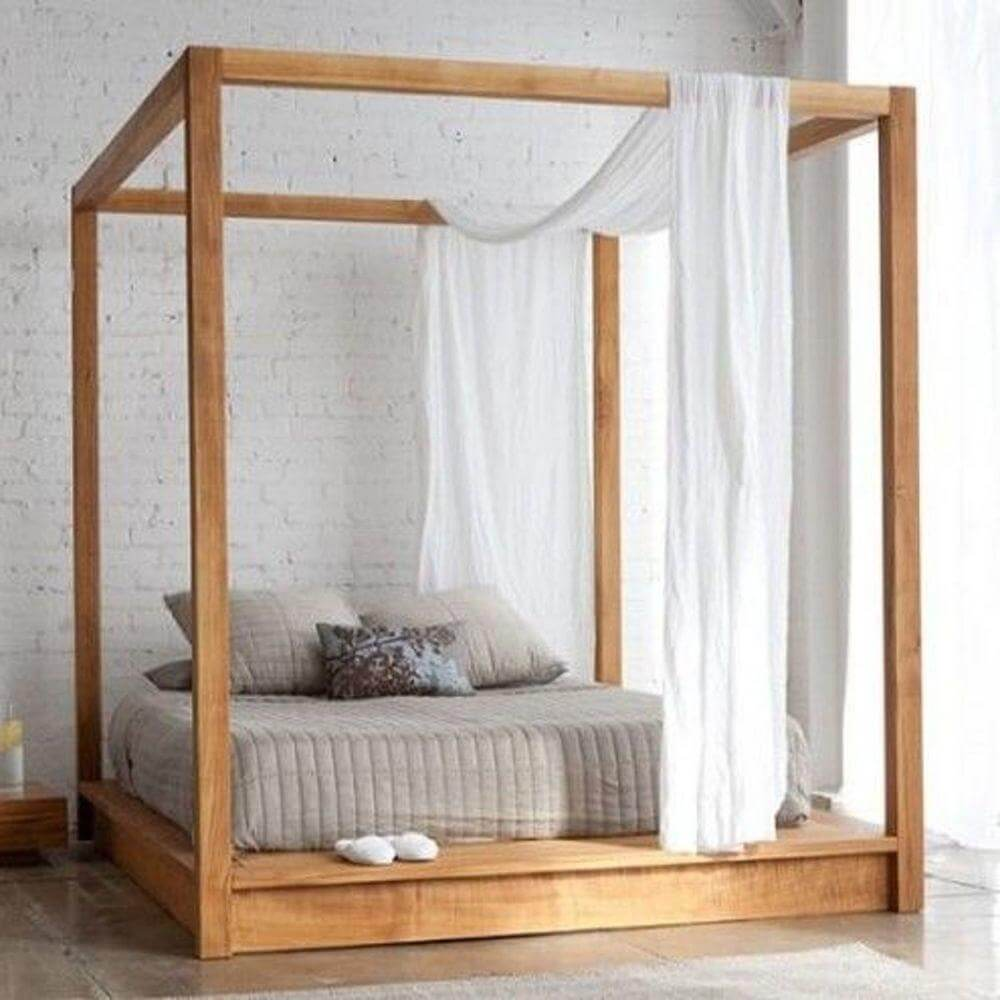 Four Poster Bed in Romantic White Bedroom