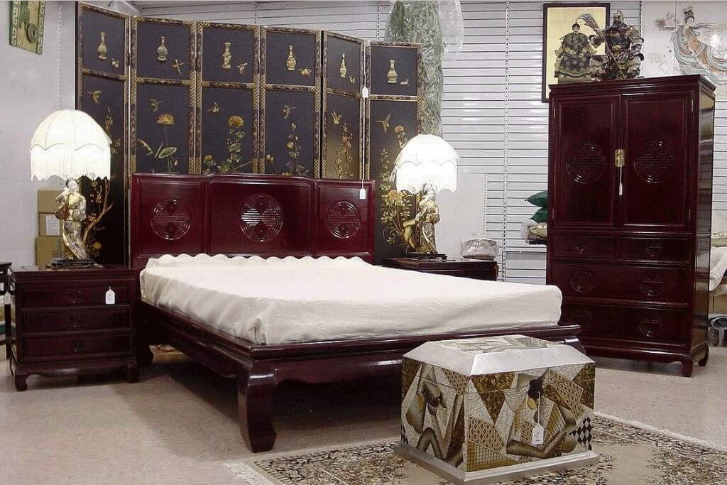Asian-inspired bedroom with dark wood furniture