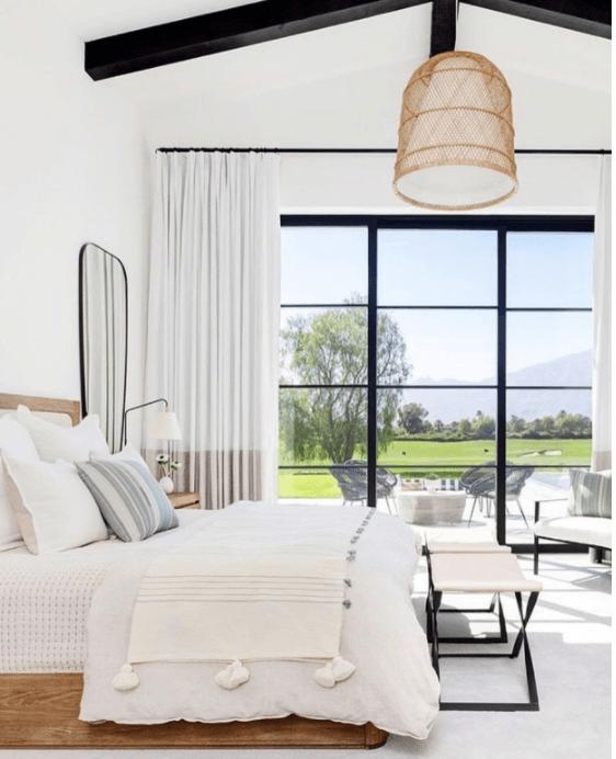 Open Sleeping Space with Black Framed Window