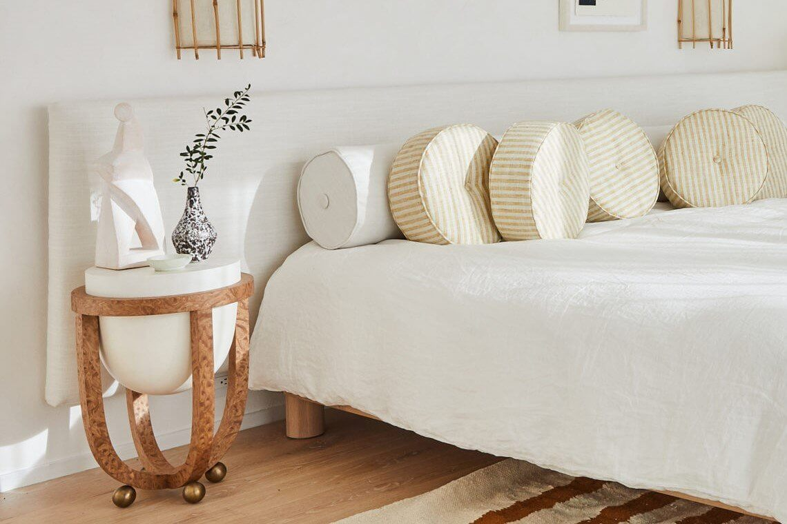 white bedroom with aesthetic bedside table