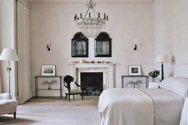 a master bedroom with fireplace