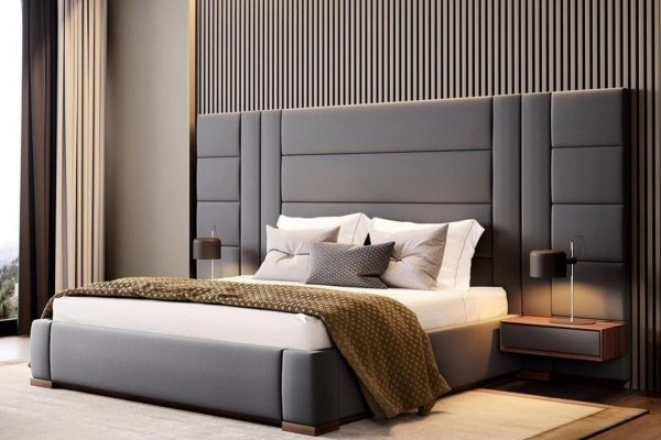 master bedroom with large gray headboard